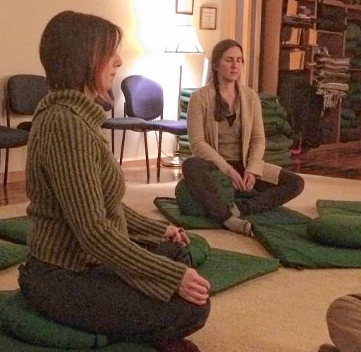 Rachel Maiore, 48, left, a mother of three, says the meditation sessions  give her some time to focus on herself. — GAZETTE STAFF/LISA SPEAR - Buy  this Image