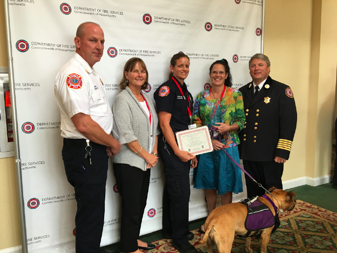 From left, Northampton Fire Chief Duane Nichols, JFK Middle School Principal Lesley Wilson, Natalie Stollmeyer, Ellen Kennedy, and Massachusetts Fire Marshal Peter Ostroskey at the 22nd annual Massachusetts Public Fire and Life Safety Education Conference at the Westford Regency Inn and Conference Center in September. Submitted photo.