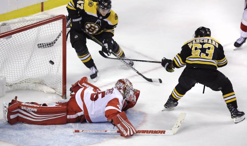 Bruins' Marchand completes hat trick with OT victor against Red Wings