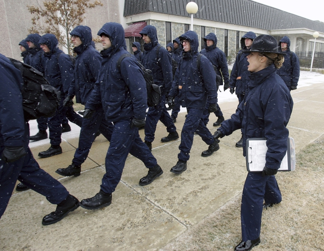 24, 2008, file photograph, Jennifer Stanton, right, a drill instructor at Coast  Guard Training Center Cape May, shouts instructions to new recruits during  ...