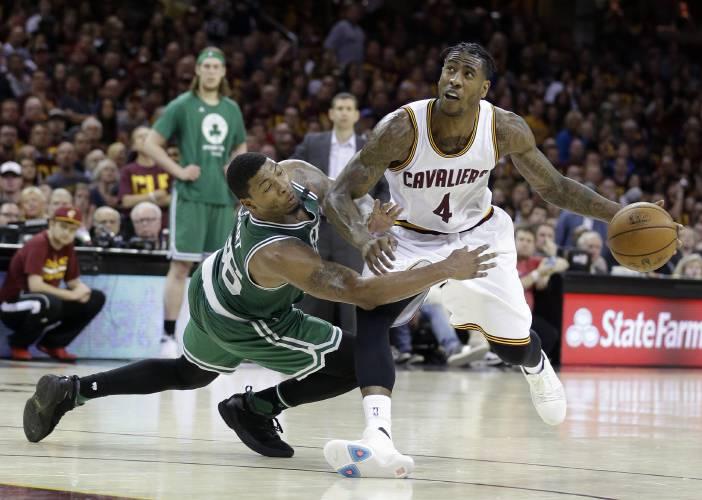 Gritty Celtics stun Cavaliers to reduce series deficit