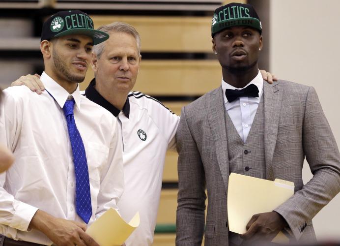 Danny Ainge, Boston Celtics president of basketball operations, talks with Celtics  draft picks Abdel Nader, left, of Egypt, and Ben Bentil, of Ghana, right,  ...