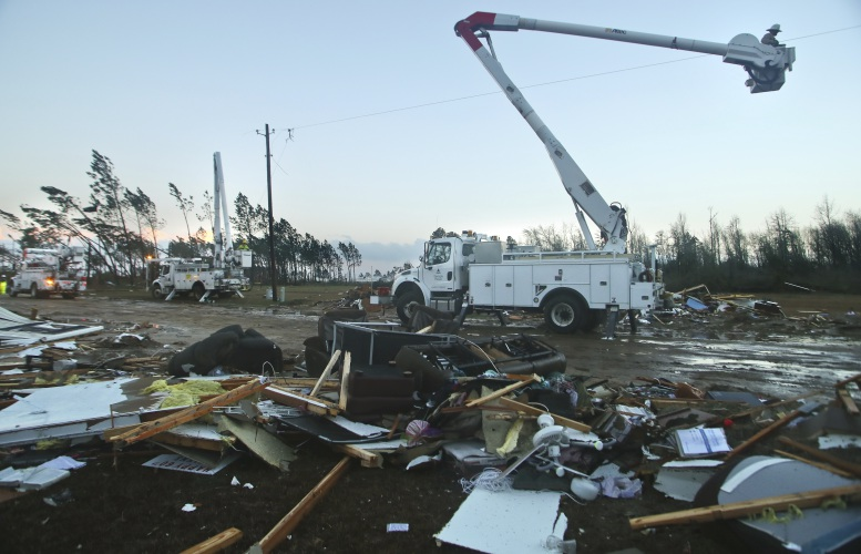 Sumter Utilities Workers Restore Power Line As The Remains Of A Mobile Home Sit Alongside Plant Farm Road On Sunday Jan 22 2017 In Adel Ga