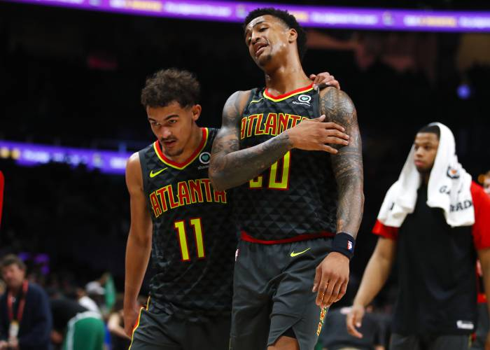 3c05360910d6 Atlanta Hawks guard Trae Young (11) and forward John Collins (20) leave the  court after the team s NBA basketball game against the Boston Celtics on ...