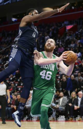 9abae93c49f Detroit Pistons center Andre Drummond (0) goes up high to defend a giants a  shot by Boston Celtics center Aron Baynes (46) during the first half of an  NBA ...