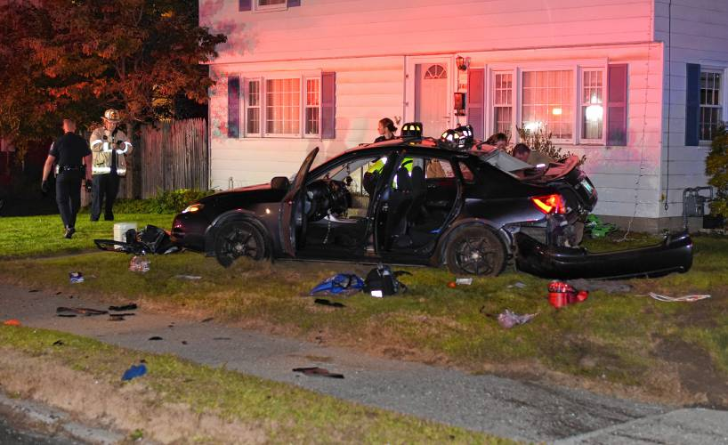 Car, Greenfield police cruiser crash at town intersection