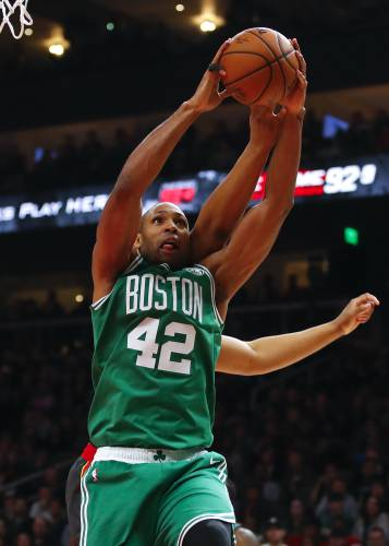 ccf0ab179493 Boston Celtics center Al Horford (42) battles for a rebound in the second  half of an NBA basketball game against the Atlanta Hawks
