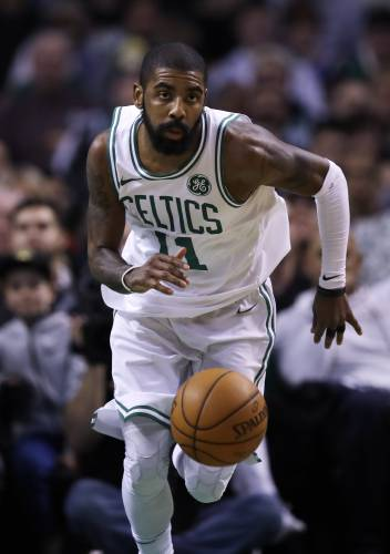 12065627253e Boston Celtics guard Kyrie Irving drives to the basket during the second  quarter of an NBA basketball game in Boston