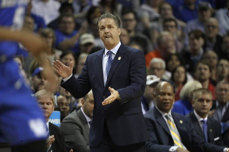 c8c0b17a3ee7 Kentucky head coach John Calipari watches the action in the first half of  the South Regional final game against North Carolina in the NCAA college ...