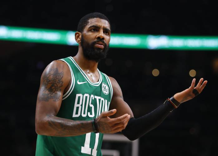 552d5c7ac1d3 Boston Celtics guard Kyrie Irving (11) reacts to a call in the second half  of an NBA basketball game against the Atlanta Hawks