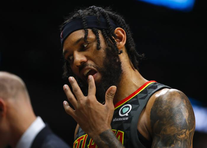 87d98fb4459b Atlanta Hawks forward DeAndre  Bembry (95) walks to the bench holding his  lip in the second half of an NBA basketball game against the Boston Celtics  on ...