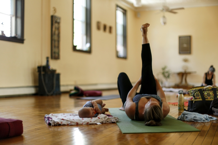 Baby yogis: Infants soaks up serenity with their moms in