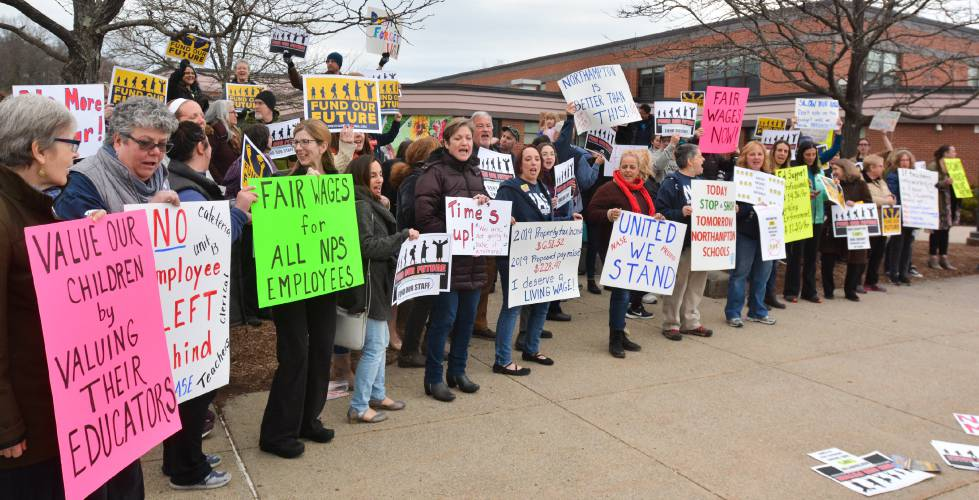 Push and pull: Teachers and staff press for higher wages, as