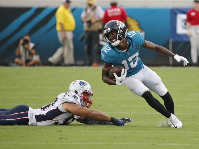 Jacksonville Jaguars wide receiver Dede Westbrook (12) runs for a touchdown  past New England Patriots linebacker Kyle Van Noy a2ed8ea95