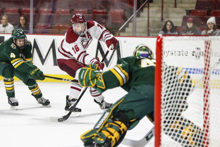 UMass Amherst defenseman Cale Makar (16) takes a shot on the net during a  NCAA hockey game against Vermont fa0ecf430