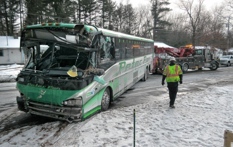 Peter Pan bus crashes into Granby home, two injured, (W/ VIDEO)