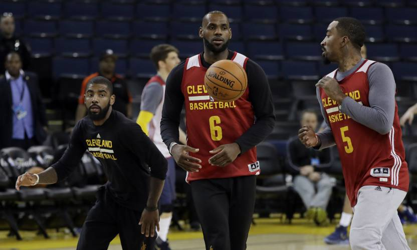 From Left Cleveland Cavaliers Kyrie Irving LeBron James And JR Smith Work On Drills During An NBA Basketball Practice Wednesday May 31 2017