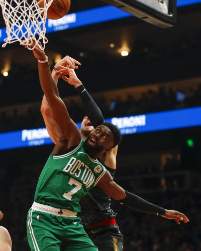 5678ca1bad9d Boston Celtics guard Jaylen Brown (7) battles for the rebound with Atlanta  Hawks center Alex Len (25) in the second half of an NBA basketball game on  ...