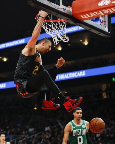 135e3ff87fa7 Atlanta Hawks center Alex Len (25) slams in the second half of an NBA  basketball game against the Boston Celtics