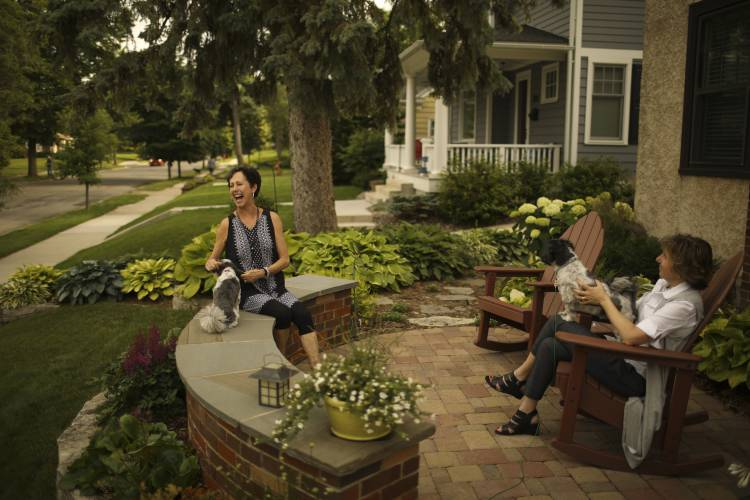 bobbi deeney left and beth gunderson of st louis park minnesota enjoy the patio in front of deeneys home many residents of their street have similar - Front Patio