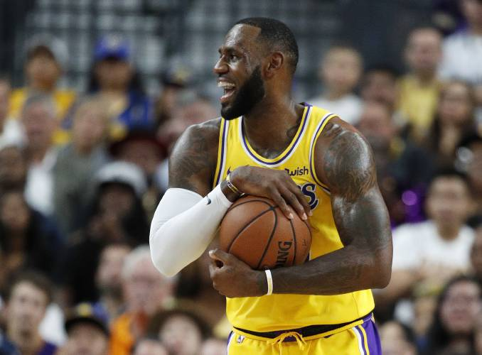 51fa1f128de Los Angeles Lakers forward LeBron James reacts after a play against the  Golden State Warriors during the first half of an NBA preseason basketball  game ...