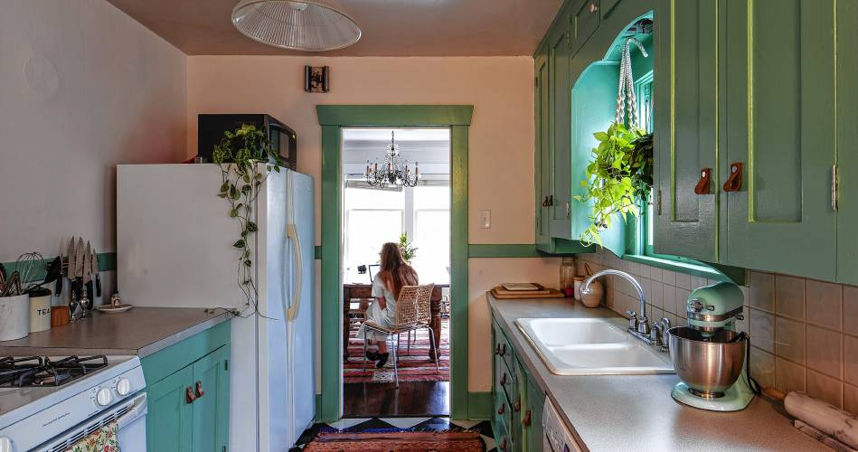 Hayley Francis Sits At A Vintage Table Under Chandelier From Craigslist Originally Dangled Between The Living And Dining Areas