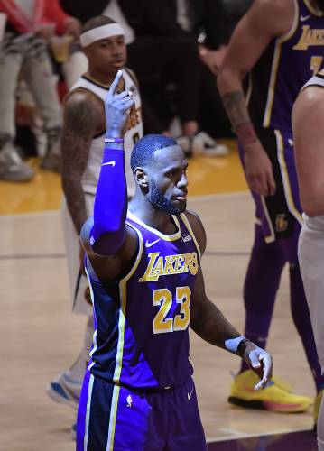 9d92a7c209e9 Los Angeles Lakers forward LeBron James gestures after scoring during the  first half of the team s NBA basketball game against the Denver Nuggets on  ...