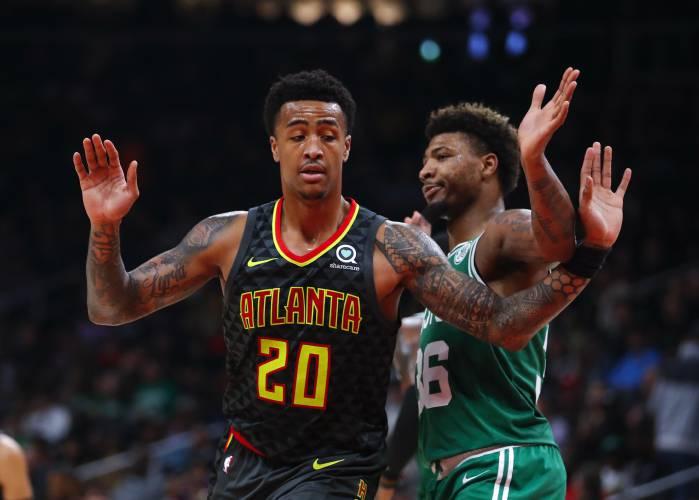 87eefa84120e Atlanta Hawks forward John Collins (20) and Boston Celtics guard Marcus  Smart (36) get tangled up in the second half of an NBA basketball game on  Saturday