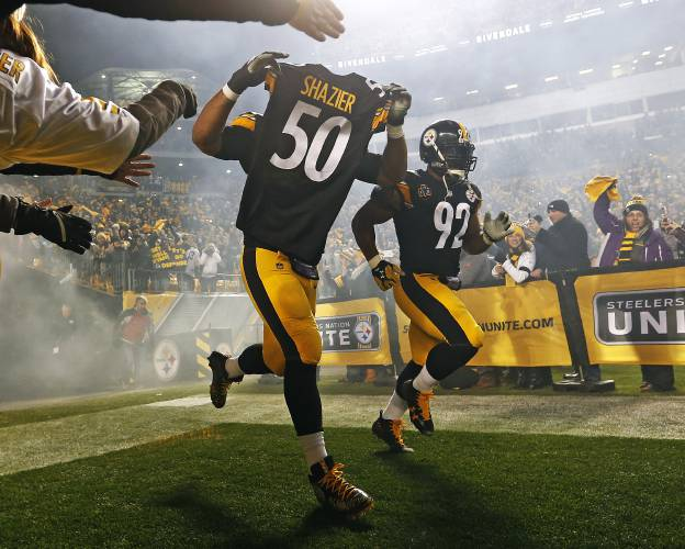 Pittsburgh Steelers defensive end Cameron Heyward (97) takes the field  holding the jersey of teammate Ryan Shazier (50) during introductions  before an NFL ... 5e7bb7150