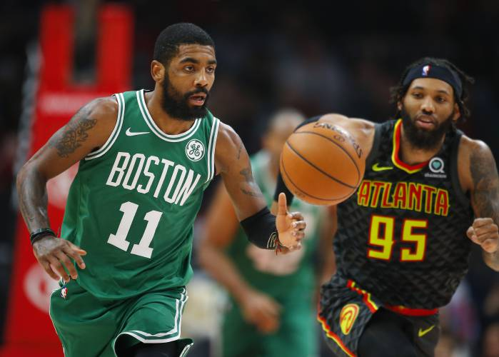 ce267b119804 Boston Celtics guard Kyrie Irving (11) brings the ball up as Atlanta Hawks  forward DeAndre  Bembry (95) defends during the first half of an NBA  basketball ...