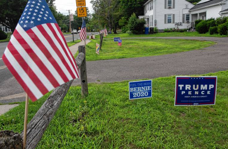 Lawn Signs Point To House Divided